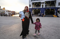 Pictured: A mother and daughter at the port Friday 26 February 2016<br />Re: Hundreds of refugees that crossed the border from Turkey to the Greek islands, have arrived at the port of Piraeus near Athens, Greece