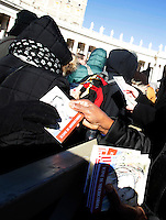 "Alcune suore distribuiscono in Piazza San Pietro libri, intitolati ""Icone di Misericordia"", donati da Papa Francesco ai fedeli nel giorno dell'Epifania. Città del Vaticano, 6 gennaio 2017.<br /> Nuns distribute booklets titled ""Icons of Mercy"" donated by Pope Francis to the faithful on Epiphany day in Saint Peter's Square at the Vatican, January 6, 2017.<br /> UPDATE IMAGES PRESS/Isabella Bonotto<br /> <br /> STRICTLY ONLY FOR EDITORIAL USE"