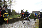 The breakaway group including Pablo Lastras Garcia (ESP) Movistar, Tom Veelers (NED) Argos-Shimano and Tyler Farrar (USA) Garmin-Barracuda enter the Molenberg climb during the 96th edition of The Tour of Flanders 2012, running 256.9km from Bruges to Oudenaarde, Belgium. 1st April 2012. <br /> (Photo by Steven Franzoni/NEWSFILE).