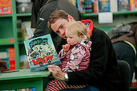 Thursday  29 May 2014, Hay on Wye, UK<br /> Pictured: A man reads to his daughter in the Hay bookshop <br /> Re: The Hay Festival, Hay on Wye, Powys, Wales UK.