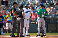Somerset Patriots manager Julio Mosquera (25) during the lineup exchange with Chris Denorfia (13) and umpires Josh Gilreath (hidden), Steven Hodgins (right), and Dane Poncsak (left) during a game against the Somerset Patriots on September 12, 2021 at TD Bank Ballpark in Bridgewater, New Jersey.  (Mike Janes/Four Seam Images)