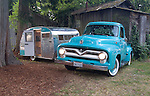 SS Ford F-100 223 Inline 6. The sea foam green is the vehicle's original color. Next to the Ford is a 13-foot 1964 Serro Scotty travel trailer.