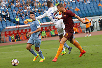 Calcio, Serie A: Roma vs Sampdoria. Roma, stadio Olimpico, 11 settembre 2016.<br /> Roma's Edin Dzeko, right, kicks to score during the Italian Serie A football match between Roma and Sampdoria at Rome's Olympic stadium, 11 September 2016. Roma won 3-2.<br /> UPDATE IMAGES PRESS/Riccardo De Luca
