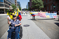 Washington D.C., USA - June 05: A woman screaming on a wheelchair during a large protest with banners and music in Washington, D.C. on June 5, 2021. The protests continue after five weeks while the government and the strike committee cannot reach an agreement. The Duque government and the National Committee did not reach an agreement and protests continue in Colombia. The protesters demand demilitarization while the government insists on an end to the blockades. (Photo by Pablo Monsalve / VIEWpress via Getty Images)