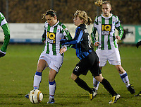 20131213 - VARSENARE , BELGIUM : Zwolle's Marije Brummel (left) pictured with Brugge's Yana Haesebroek during the female soccer match between Club Brugge Vrouwen and PEC Zwolle Ladies , of  matchday 14  in the BENELEAGUE competition. Friday 13th December 2013. PHOTO DAVID CATRY