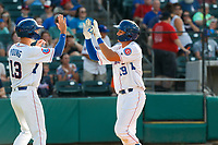 Tennessee Smokies third baseman Chase Strumpf (19) celebrates a home run with Jared Young (13) during a game against the Rocket City Trash Pandas at Smokies Stadium on July 2, 2021, in Kodak, Tennessee. (Danny Parker/Four Seam Images)