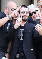 HOLLYWOOD, LOS ANGELES, CA, USA - JULY 07: John Varvatos, Ringo Starr, David Lynch at the announcement of special collaboration of John Varvatos and Ringo Starr on occasion of Ringo's birthday at Capitol Records Studio on July 7, 2014 in Hollywood, Los Angeles, California, United States. (Photo by Xavier Collin/Celebrity Monitor)