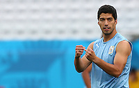 Luis Suarez of Uruguay holds his fists up as he trains in the Arena Corinthians, Sao Paulo ahead of his sides Group D crunch fixture vs England tomorrow