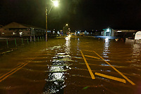 Pictured: The flooded Pensarn Road in Carmarthen, Wales, UK. Saturday 13 October 2018<br /> Re: River Towy has burst its banks and adjacent properties have flooded, caused by storm Callum, in Carmarthen, west Wales, UK.