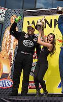 Jun. 2, 2013; Englishtown, NJ, USA: NHRA top fuel dragster driver Shawn Langdon celebrates with a promo model after winning the Summer Nationals at Raceway Park. Mandatory Credit: Mark J. Rebilas-