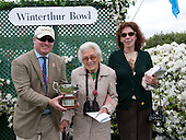 The Fields Stables' Betty Merck, center, and Mimi Voss accept the Winterthur Bowl trophy.