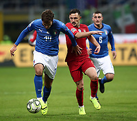 Football: Uefa Nations League Group 3match Italy vs Portugal at Giuseppe Meazza (San Siro) stadium in Milan, on November 17, 2018.<br /> Italy's Federico Chiesa (l) in action with Portugal's Mario Rui (r) during the Uefa Nations League match between Italy and Portugal at Giuseppe Meazza (San Siro) stadium in Milan, on November 17, 2018.<br /> UPDATE IMAGES PRESS/Isabella Bonotto