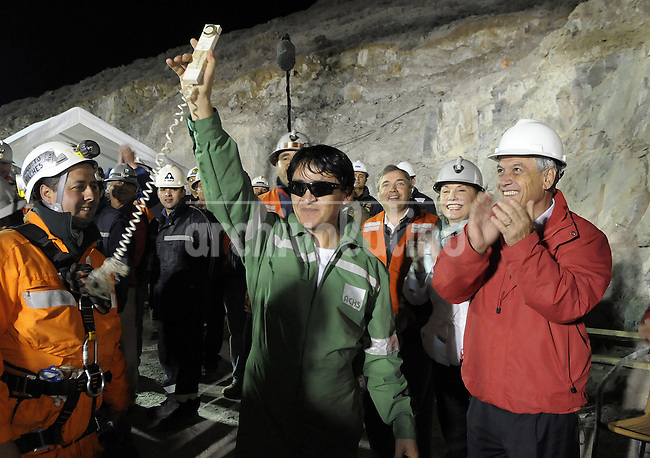 President of Chile Sebastian Piñera plays a ball with former soccer player and   miner Franklin Lobos after being  rescued from the the bottom of the tunnel were they have been trapped since August 5th. The rescue operation was a complete success with all the 33 miners alive back home.