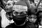 Summer '99-- Jakarta, Indonesia -- A young security guard at a political rally.