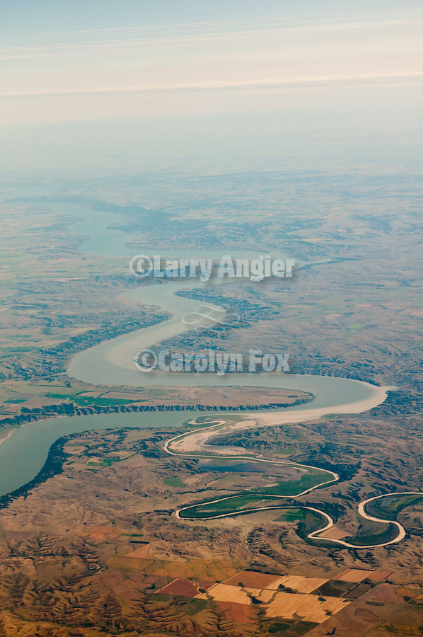 Confluence of the White and Missouri Rivers at Peterson Bottoms near Oacoma, South Dakota. ..Western South Dakota landscape and the Missouri River during airline travel via Delta Airlines from Sacramento, Calif., to Minneapolis, Minn. over Nevada, Utah, Wyoming, North Dakota, and Minnesota.