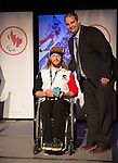 Calgary, AB - June 5 2014 - Caleb Brousseau receives his Paralympic Ring from Rob Mason, of HBC, during the Celebration of Excellence Paralympic Ring Reception in Calgary. (Photo: Matthew Murnaghan/Canadian Paralympic Committee)
