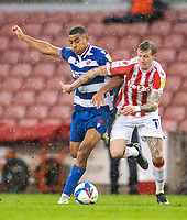 6th February 2021; Bet365 Stadium, Stoke, Staffordshire, England; English Football League Championship Football, Stoke City versus Reading; Andy Rinomhota of Reading under pressure from James McClean of Stoke City