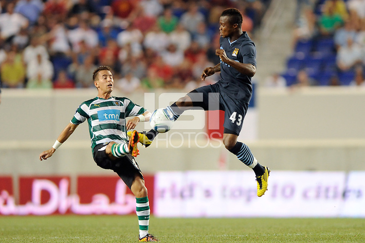 Joao Pereira (47) of Sporting Clube de Portugal and Alex Tchuimeni-Nimely (43) of Manchester City F. C. Sporting Clube de Portugal defeated Manchester City F. C. 2-0 during a Barclays New York Challenge match at Red Bull Arena in Harrison, NJ, on July 23, 2010.