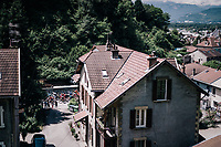 neutralised peloton cruising through town<br /> <br /> Stage 5: Grenoble > Valmorel (130km)<br /> 70th Critérium du Dauphiné 2018 (2.UWT)