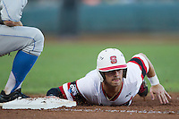 North Carolina State outfielder Bryan Adametz (15) dives back to first base against the UCLA Bruins during Game 8 of the 2013 Men's College World Series on June 18, 2013 at TD Ameritrade Park in Omaha, Nebraska. The Bruins defeated the Wolfpack 2-1, eliminating North Carolina State from the tournament. (Andrew Woolley/Four Seam Images)