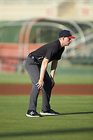 Umpire Sean Cassidy handles the calls on the bases during the South Atlantic League game between the Rome Braves and the Kannapolis Intimidators at Kannapolis Intimidators Stadium on July 2, 2019 in Kannapolis, North Carolina.  The Intimidators walked-off the Braves 5-4. (Brian Westerholt/Four Seam Images)