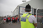 Hartlepool United 0 Middlesbrough 0, 20/07/2013. Victoria Ground, Pre-Season Friendly. A police officer watching on as supporters of Hartlepool United and Middlesbrough make their way to the Victoria Ground, Hartlepool, before the pre-season friendly between the two teams. Hartlepool were relegated to League Two at the end of the 2012-13 season whilst their Teesside neighbours remained two divisions above them in the Championship. The game ended in a no-score draw watched by a crowd of 2307. Photo by Colin McPherson.