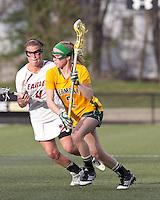 University of Vermont midfielder Natalie Jones (2) brings the ball forward as Boston College attacker Brooke Blue (4) pressures. Boston College defeated University of Vermont, 15-9, at Newton Campus Field, April 4, 2012.
