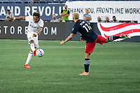 FOXBOROUGH, UNITED STATES - AUGUST 20: Jose Martinez #8 of Philadelphia Union kicks the ball downfield with Kelyn Rowe #11 of New England Revolution coming in to tackle during a game between Philadelphia Union and New England Revolution at Gilette on August 20, 2020 in Foxborough, Massachusetts.