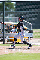 Chicago White Sox catcher Michael Hickman (26) follows through on his swing during an Instructional League game against the Oakland Athletics at Lew Wolff Training Complex on October 5, 2018 in Mesa, Arizona. (Zachary Lucy/Four Seam Images)
