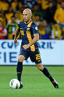 Mark BRESCIANO (23) of Australia controls the ball during the FIFA 2014 World Cup Group D Asian Qualifier match between Australia and Saudi Arabia at AAMI Park in Melbourne, Australia...This image is not for sale on this web site. Please contact Southcreek Global Media for licensing:.Toll Free: 1.800.934.5030.Canada: 701 Rossland Rd. East, Suite 315, Whitby, Ontario, Canada, L1N 9K3.USA: 10792 Baron Dr, Parma OH, USA 44130.Web: http://southcreekglobal.net/ and http://southcreekglobal.com/