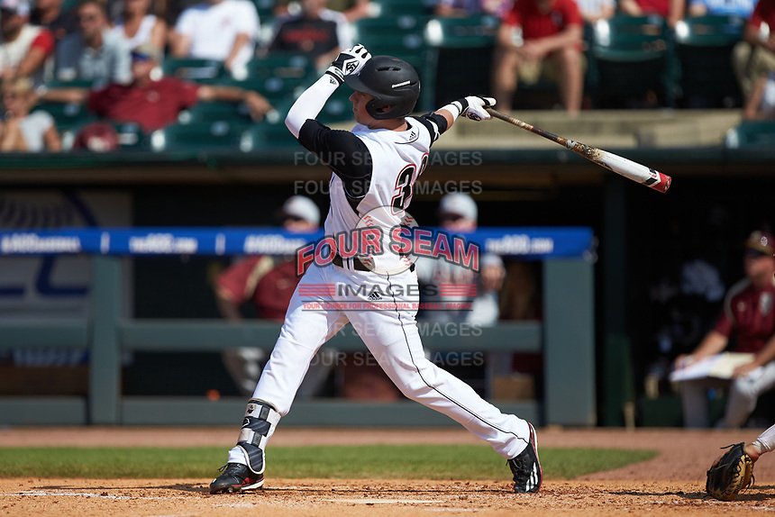 Brendan McKay (38) of the Louisville Cardinals follows through on his swing against the Florida State Seminoles in Game Eleven of the 2017 ACC Baseball Championship at Louisville Slugger Field on May 26, 2017 in Louisville, Kentucky. The Seminoles defeated the Cardinals 6-2. (Brian Westerholt/Four Seam Images)