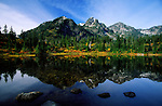 The still waters of a mountain lake makes for a mirror image.