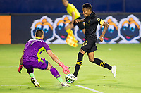 CARSON, CA - SEPTEMBER 06: Mark-Anthony Kaye #14 of LAFC attempts to dribble past David Bingham #1 GK of the Los Angeles Galaxy during a game between Los Angeles FC and Los Angeles Galaxy at Dignity Health Sports Park on September 06, 2020 in Carson, California.