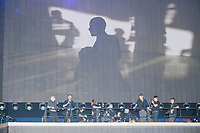Photographers stand on a riser behind the stage while a video about Obama's presidency plays before President Barack Obama's speech at the Democratic National Convention at the Wells Fargo Center in Philadelphia, Pennsylvania, on Wed., July 27, 2016.