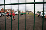 Charnock Richard 2 Freckleton 1, Mossie Park, West Lancashire Football League. The players of Charnock Richard (green) and visitors Freckleton make their way across the car park to the pitch from the adjoining clubhouse at half-time in a West Lancashire Football League fixture at Mossie Park, Charnock Richard. Charnock Richard won by two goals to one. The league was formed in 1904, although 1905-06 was the first season and sits at step seven of the pyramid system. Photo by Colin McPherson.