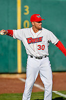 Ty Barkell (30) of the Orem Owlz warms up in the outfield before the game against the Ogden Raptors in Pioneer League action at Home of the Owlz on June 25, 2016 in Orem, Utah. Orem defeated Ogden 4-1.  (Stephen Smith/Four Seam Images)