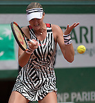 May 28,2016:   Kristina Mladenovic (FRA) battled  Serena Williams (USA) to a score of 6-4, 6-6 before the rain delay at  Roland Garros being played at Stade Roland Garros in Paris, .  ©Leslie Billman/Tennisclix