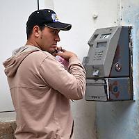 Cuba, Havana.  Public Pay Phones Still Dominate Cuba's Phone Service, Rather than Mobile Phones.