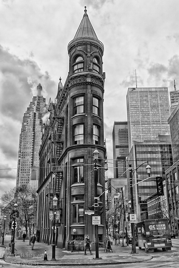 A black and white view of the landmark Flatiron Building in Toronto.