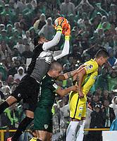 BOGOTA - COLOMBIA -25-02-2017: Diego Novoa (Izq.) y Andres Correa (Cent.) jugadores de La Equidad disputan el balón con Andres Uribe (Der.) jugador de Atletico Nacional, durante partido entre La Equidad y Atletico Nacional, por la fecha 5 de la Liga Aguila I-2017, jugado en el estadio Nemesio Camacho El Campin de la ciudad de Bogota. / Diego Novoa (L) and Andres Correa (C) players of La Equidad vie for the ball with Andres Uribe (R) player of Atletico Nacional, during a match between La Equidad and Atletico Nacional, for the  date 5 of the Liga Aguila I-2017 at the Nemesio Camacho El Campin Stadium in Bogota city, Photo: VizzorImage  / Luis Ramirez / Staff.