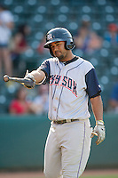Colorado Springs Sky Sox third baseman Rafael Ynoa (6) points toward the dugout at the Chickasaw Bricktown Ballpark during the Pacific League game against the Oklahoma City RedHawks on August 3, 2014 in Oklahoma City, Oklahoma.  The RedHawks defeated the Sky Sox 8-1.  (William Purnell/Four Seam Images)