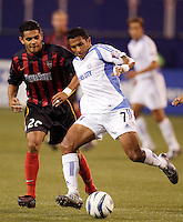 The MetroStars' Amado Guevara shadows the Wizard's Diego Gutierrez. The Kansas City Wizards were defeated by  the NY/NJ MetroStars to a 1 to 0 at Giant's Stadium, East Rutherford, NJ, on May 30, 2004.