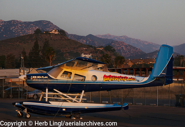 San Diego Seaplane's Helio Courier, N295HC, an H-295 on floats at Gillespie Field,, SEE, El Cajon, San Diego County at dusk.