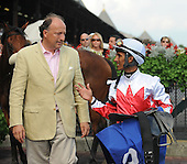 Miss World, with jockey Rajiv Maragh in the red and white colors, won the $300,000 Grade 1 Garden City Stakes for fillies and mares at Belmont Park on Saturday for trainer Christophe Clement, upsetting favored Gozzip Girl. These photos are from Miss World's previous start, a victory last month on the inner turf at Saratoga.