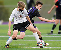 Oregon's Quinn Belville (14) competes for the ball with Waunakee's Isaiah Jakel (20), as Oregon takes on Waunakee in Wisconsin WIAA Badger Conference boys high school soccer on Tuesday, Apr. 27, 2021 at Waunakee High School
