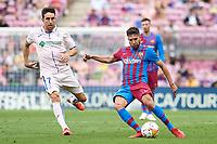 29th August 2021; Nou Camp, Barcelona, Spain; La Liga football league, FC Barcelona versus Getafe; Jordi Alba of FC Barcelona crosses in front of Mata of Getafe