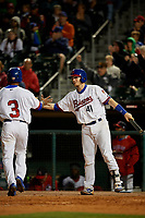 Buffalo Bisons catcher Danny Jansen (41) high fives Teoscar Hernandez (3) after scoring a run during a game against the Pawtucket Red Sox on August 31, 2017 at Coca-Cola Field in Buffalo, New York.  Buffalo defeated Pawtucket 4-2.  (Mike Janes/Four Seam Images)