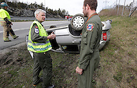 Anesthesiologist Hallstein Sørebø discuss with rescue paramedic Lars Markengbakken at an accident scene.  Crew from Norwegian Air Force 330 squadron, flying Westland Sea King helicopter. The core mission of the squadron is SAR (search and rescue), but they also fly HEMS (Helicopter Emergency Medical Service), complementing the civilian air ambulance service, and use a car in their local area. <br />