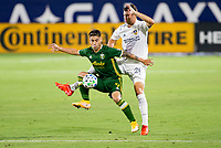 CARSON, CA - OCTOBER 07: Felipe Mora #9 of the Portland Timbers moves with the ball past Nicholas DePuy #20 of the Los Angeles Galaxy during a game between Portland Timbers and Los Angeles Galaxy at Dignity Heath Sports Park on October 07, 2020 in Carson, California.