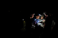 Photo story of Philmont Scout Ranch in Cimarron, New Mexico, taken during a Boy Scout Troop backpack trip in the summer of 2013. Photo is part of a comprehensive picture package which shows in-depth photography of a BSA Ventures crew on a trek.  In this photo headlights light up a BSA Venture Crew as they study their map in the early morning hours in the backcountry at Philmont Scout Ranch.   <br /> <br /> The  Photo by travel photograph: PatrickschneiderPhoto.com
